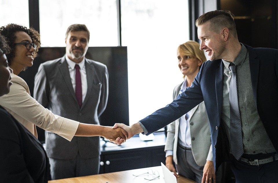 Business meeting proposal agreement handshake